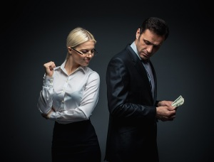 Businessman and businesswoman with money